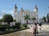 . В 12 км от Кап-Аитьена сохранились остатки резиденции Анри Кристофа, дворца Сан-Суси и крепости Лаферьер. Неподалеку руины дворца, где жила сестра Наполеона Полина. Большинство туристов приезжают сюда, чтобы насладиться отдыхом на Карибах, поплавать в теплых водах, заняться дайвингом. В 7-ми км от города расположен шикарный пляжный курорт Лабадье.