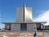 Когда-то на этом месте стояла церковь с таким же названием, но она была уничтожена пожаром в 1962 г. Поначалу хотели ее восстановить в прежнем, традиционном виде, но потом решено было возвести что-то грандиозное и необычное.